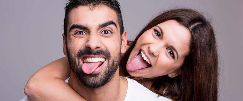 couple-sticking-out-tongues