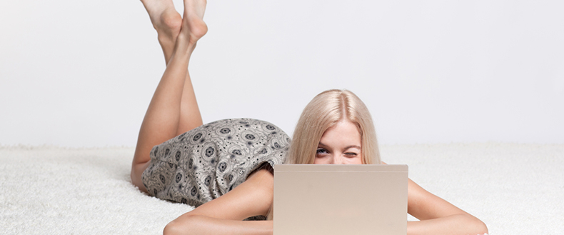 Winking woman with laptop