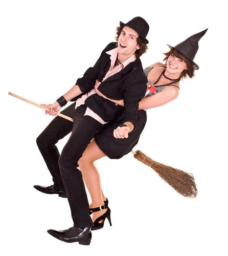 Halloween girl witch on broom bear man.