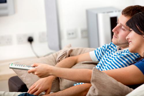 Loving couple watching tv