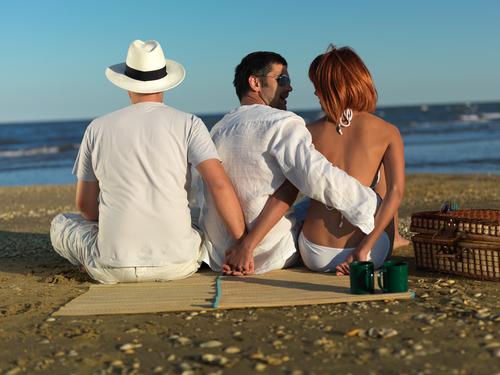 woman cheating on boyfriend by sea shore